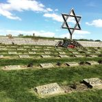 A photo of marked and unmarked graves of those we have lost at Terezin's concentration camp, much like the well known concentration camp of Auschwitz.