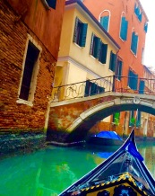 Exploring the foggy canals of Venice in a gondola.
